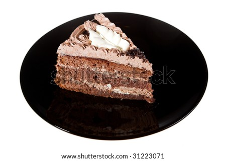 chocolate cake on the black plate isolated on white