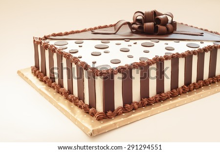 Chocolate cake on white background, decoration details.  - stock photo