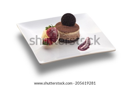 chocolate cake round with cookie on the top and strawberry isolated on white background - stock photo