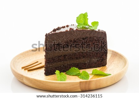 Chocolate cake slice in wooden plate on white background.  - stock photo