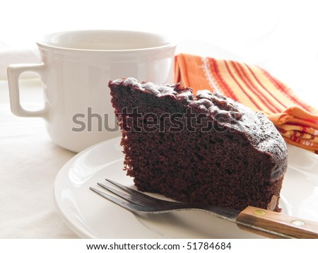 Chocolate Cake Slice on white dish. - stock photo