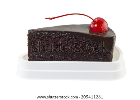 Chocolate cake slice with red cherry on white background - stock photo