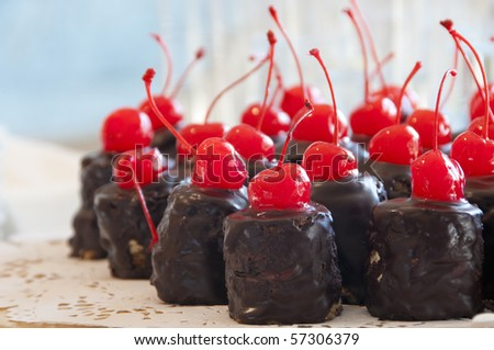 Chocolate cake with a red cherry - stock photo