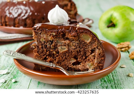 Chocolate cake with Apple and chocolate frosting. Simple home baking - stock photo