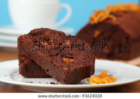 Chocolate cake with candied orange peel. Shallow dof - stock photo