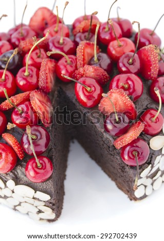 Chocolate cake with cherries. - stock photo