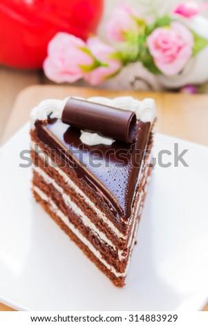 Chocolate cake with chocolate cream in white dish - stock photo