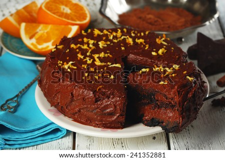 Chocolate cake with chocolate cream on wooden table close-up - stock photo