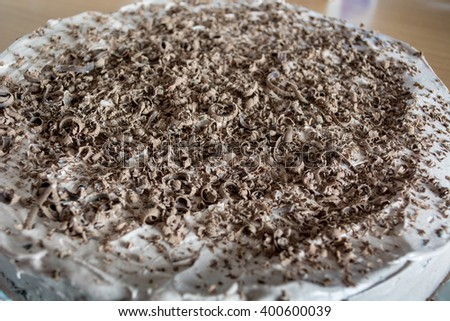 Chocolate cake with chocolate crumbs on it
