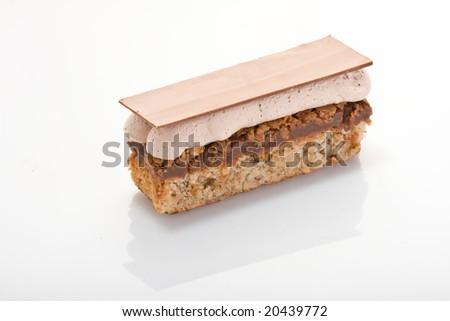 Chocolate cake with ground walnut on acrylic glass. - stock photo