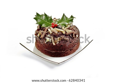 Chocolate cake with holly and red berries - isolated - stock photo