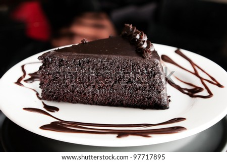 chocolate cake with icing - stock photo