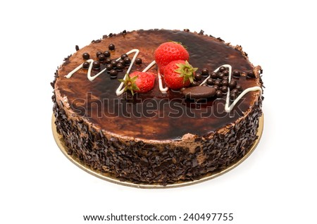 chocolate cake with icing and strawberries - stock photo