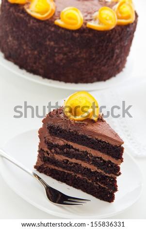 chocolate cake with oranges. - stock photo