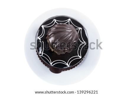 Chocolate cake with oyster shape decoration on white plate