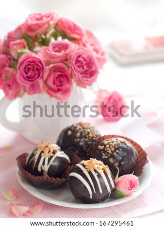 Chocolate cake with pink roses for celebration, selective focus - stock photo
