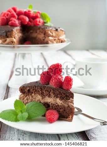 Chocolate cake with raspberries - stock photo