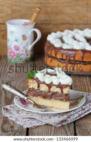 Chocolate cake with rum syrup and whipped cream - stock photo