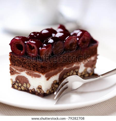 Chocolate cake with sour cherries - stock photo