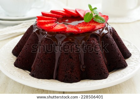 Chocolate cake with strawberries. - stock photo