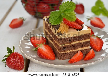 Chocolate cake with strawberries on a white background - stock photo