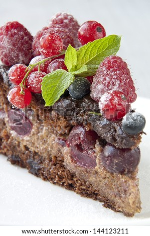 Chocolate cake with strawberry and raspberry and cherries