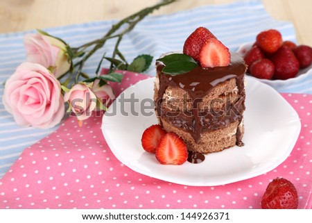 Chocolate cake with strawberry on table close-up