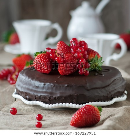 Chocolate cake with strawberry, selective focus and square image - stock photo