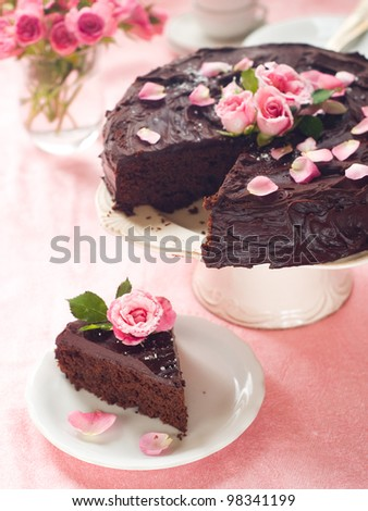 Chocolate cake with sugar rose, selective focus - stock photo