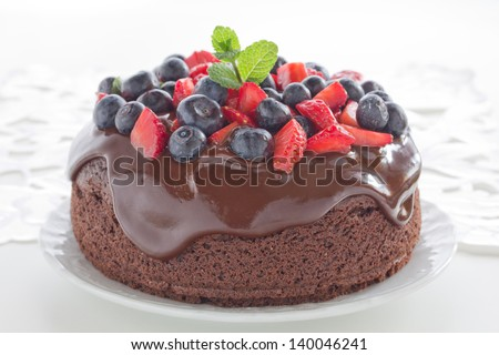 Chocolate cake with summer berries. - stock photo
