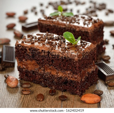 chocolate cakes on a brown background - stock photo