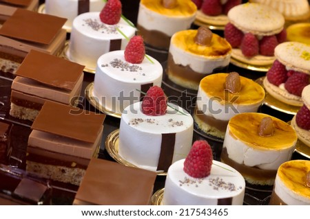 Chocolate cakes on display a confectionery shop in France. - stock photo