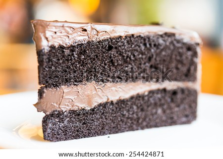 Chocolate cakes on white plate in coffee shop - stock photo
