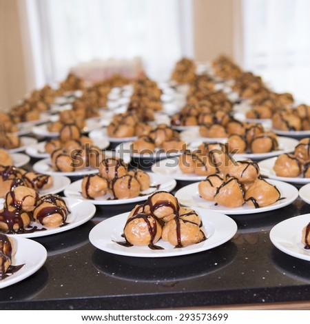 Chocolate Cakes, profiteroles on a plate - stock photo