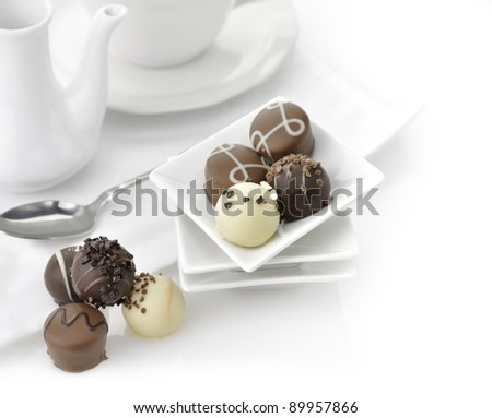 Chocolate Candies Assortment In A White Dish - stock photo