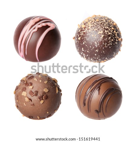 Chocolate candies collection. Beautiful Belgian truffles isolated on white background - stock photo