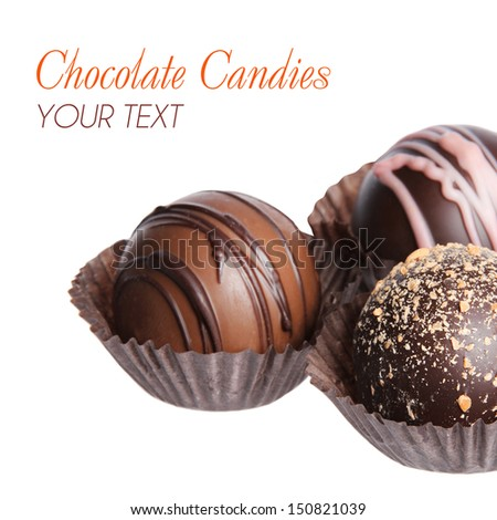 Chocolate candies. Collection of beautiful Belgian truffles in wrapper isolated on white background - stock photo
