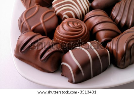 Chocolate candies in a dish - stock photo