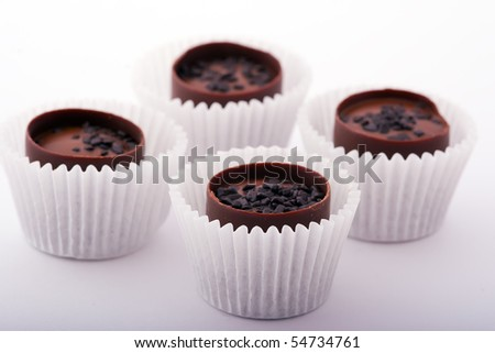 Chocolate candies in paper cups - stock photo