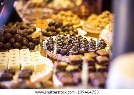 Chocolate candies on showcase in the store - stock photo