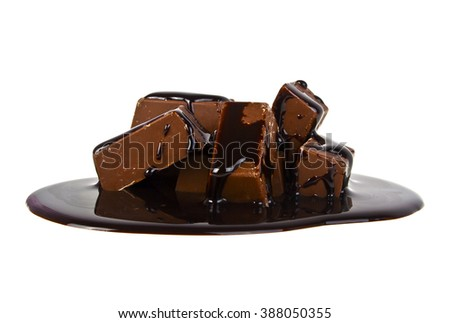 Chocolate candies poured chocolate isolated on white background - stock photo