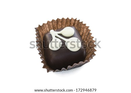 Chocolate candy decorated with white glaze isolated over white - stock photo