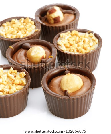 chocolate candy with nuts on a white background - stock photo