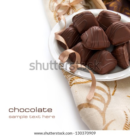 Chocolate candy with sweet cream inside on the white background - stock photo