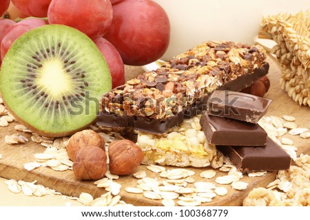 Chocolate cereal bar with grapes, kiwi and nuts. - stock photo