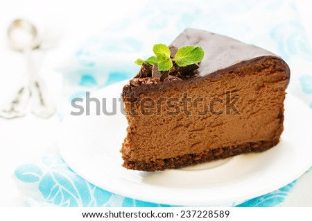 chocolate cheesecake with chocolate glaze on blue white background. tinting. selective focus - stock photo