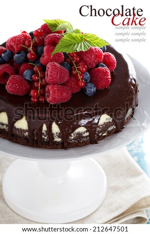 Chocolate cheesecake with fresh berries on a brownie layer - stock photo