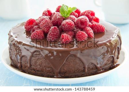 Chocolate cheesecake with raspberries. - stock photo