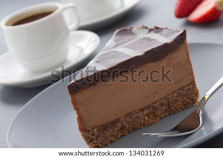 Chocolate Cheesecake with three kinds of chocolate. - stock photo