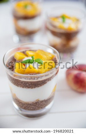 Chocolate Chia Pudding Dessert with ripe peach - stock photo